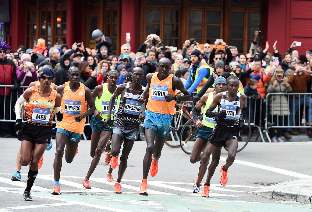 . Kenya\'s Wilson Kipsang (C) runs along with other participants in the New York City Marathon on November 2, 2014. Kipsang won the New York City Marathon men\'s title, defeating Ethiopia\'s Lelisa Desisa with a strong push to the finish line. Kipsang won the 26.2-mile race in an unofficial time of two hours, 20 minutes and 59 seconds with Desisa four seconds back. AFP PHOTO/Jewel SamadJEWEL SAMAD/AFP/Getty Images