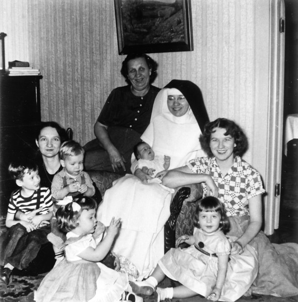 Christmas 1953  Daria Curry with Jerry Curry and Jim Smock, Bertha Jacob, Sr. Ignatius holding Pat, Maria Smock with Jan, Barbara Wick in front.