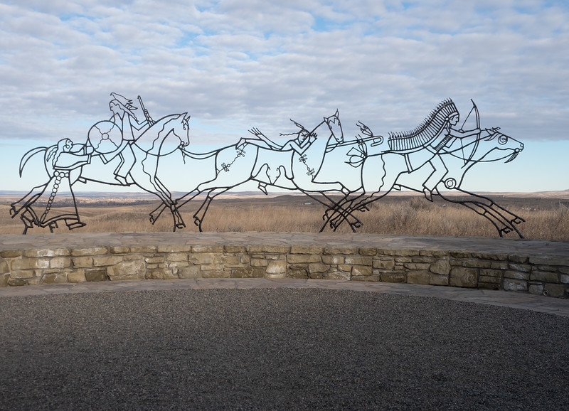 Wrought Iron sculptures of native americans riding horses