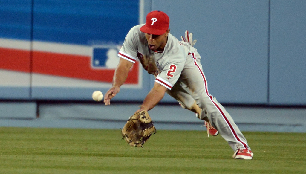. Philadelphia Phillies center fielder Ben Revere dives and catches a line drive by Los Angeles Dodgers\' Matt Kemp (not pictured) in the sixth inning of a baseball game on Tuesday, April 22, 2013 in Los Angeles.   (Keith Birmingham/Pasadena Star-News)