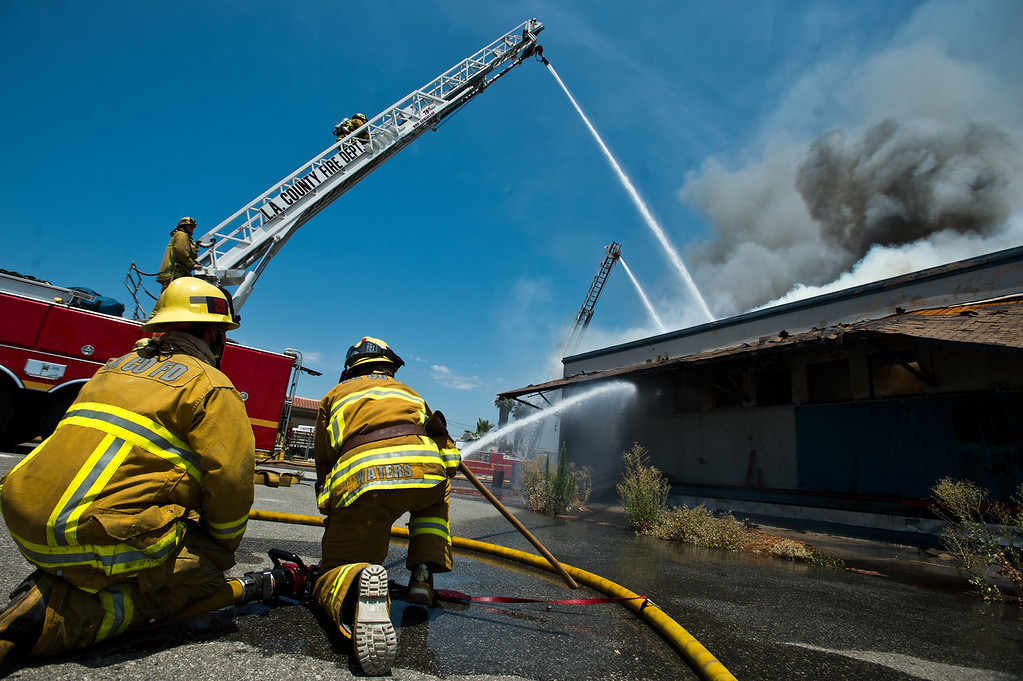 . Los Angeles County firefighters battle a 3-alarm fire at an abandoned warehouse near 9th Avenue and Clark Avenue in City of Industry on Tuesday, July 9, 2013. (SGVN/Staff Photo by Watchara Phomicinda)
