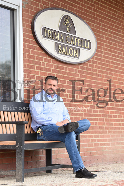 Chris Young, president of Prima Capelli Salon Inc., has added plexiglass dividers between stations at his salon on located in Center Township at 1617 N. Main Street Ext., along with other safety measures like multiple air filters, in preparation for when the salon is allowed to reopen. Photo by Lauryn Halahurich/Butler Eagle