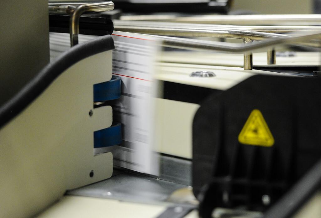 . Mail-in ballets are processed at the Registrar of Voters office in San Bernardino on Monday, Nov. 4, 2013. (Photo by Rachel Luna / San Bernardino Sun)
