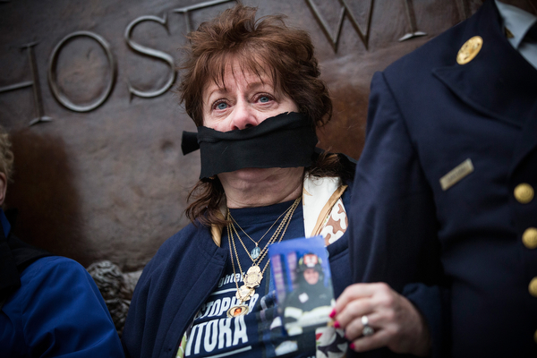 . Maureen Santora, mother of firefighter Christopher Santora, a victim of the September 11, 2001 attack, and other victim\'s family members protest the decision by city officials to keep unidentified human remains of the 9-11 victims at the 9-11 Museum at the World Trade Center site, on May 10, 2014 in New York City. The decision by city officials to keep the remains at the museum until they are able to be identified has drawn both support and criticism by families of victims. The remains were moved early this morning from the medical examiner\'s repository to the 9-11 Museum.  (Photo by Andrew Burton/Getty Images)