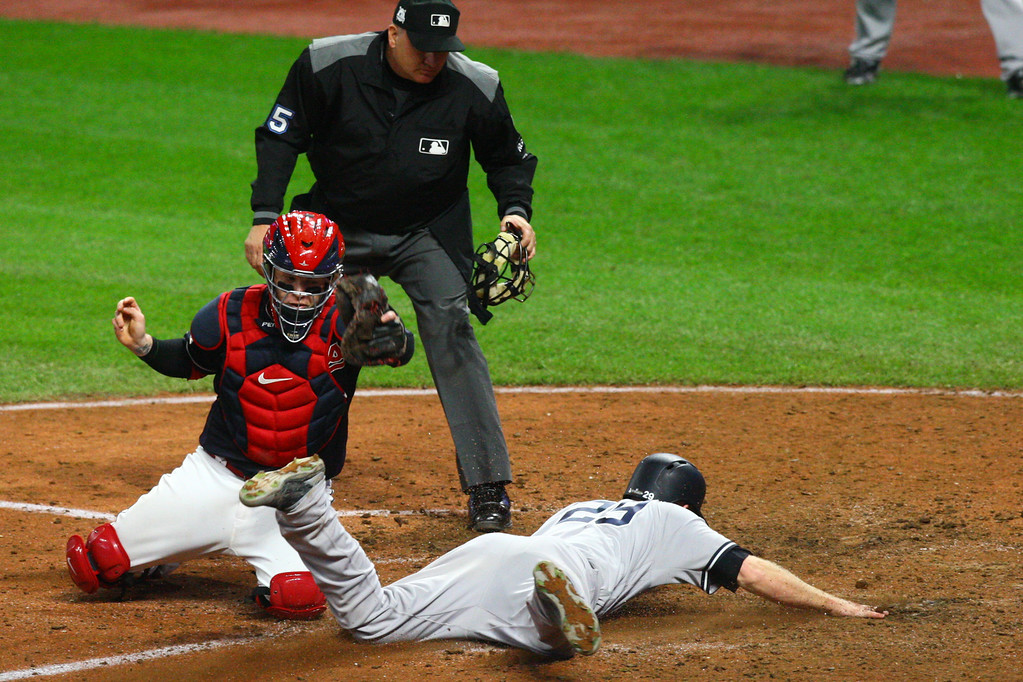 . David Turben - The News-Herald 2017 - Baseball - ALDS Game 5 Quick Pics.  Yankees baserunner Todd Frazier (29) scores a second run in the top of the 9th inning to add two insurance runs to their one run lead on yet another error by the indians.