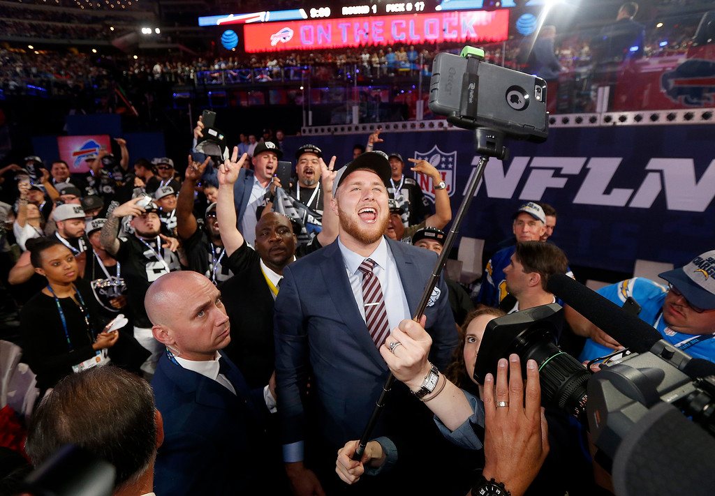 . UCLA\'s Kolton Miller takes a selfie with fans as he celebrates being selected by the Oakland Raiders during the first round of the NFL football draft, Thursday, April 26, 2018, in Arlington, Texas. (AP Photo/Michael Ainsworth)