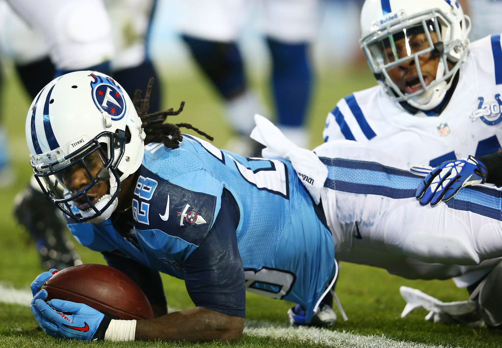 . NASHVILLE, TN - NOVEMBER 14:  Chris Johnson #28 of the Tennessee Titans scores a first quarter touchdown against the defense of  Antoine Bethea #41 of the Indianapolis Colts at LP Field on November 14, 2013 in Nashville, Tennessee.  (Photo by Andy Lyons/Getty Images)