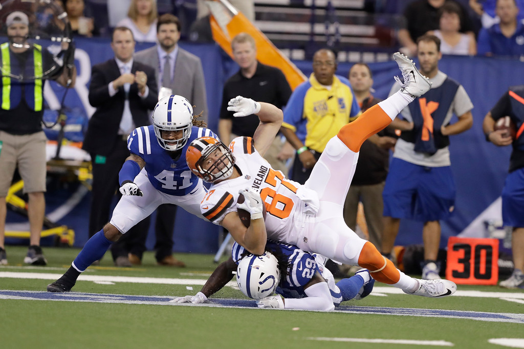 . Cleveland Browns tight end Seth DeValve (87) is tackled by Indianapolis Colts free safety Malik Hooker (29) during the first half of an NFL football game in Indianapolis, Sunday, Sept. 24, 2017. (AP Photo/Darron Cummings)