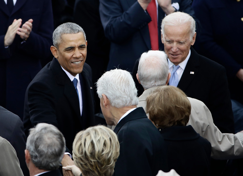 . President Barack Obama greets Former President Bill Clinton before the 58th Presidential Inauguration at the U.S. Capitol in Washington, Friday, Jan. 20, 2017. Right is Vice President Joe Biden. (AP Photo/Matt Rourke)
