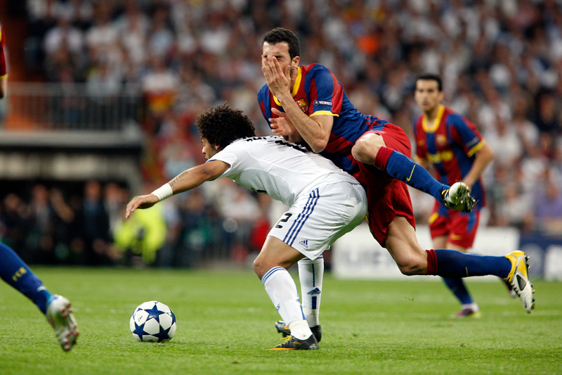 Marcelo committing foul on Busquets, UEFA Champions League Semifinals game between Real Madrid and FC Barcelona, Bernabeu Stadiumn, Madrid, Spain