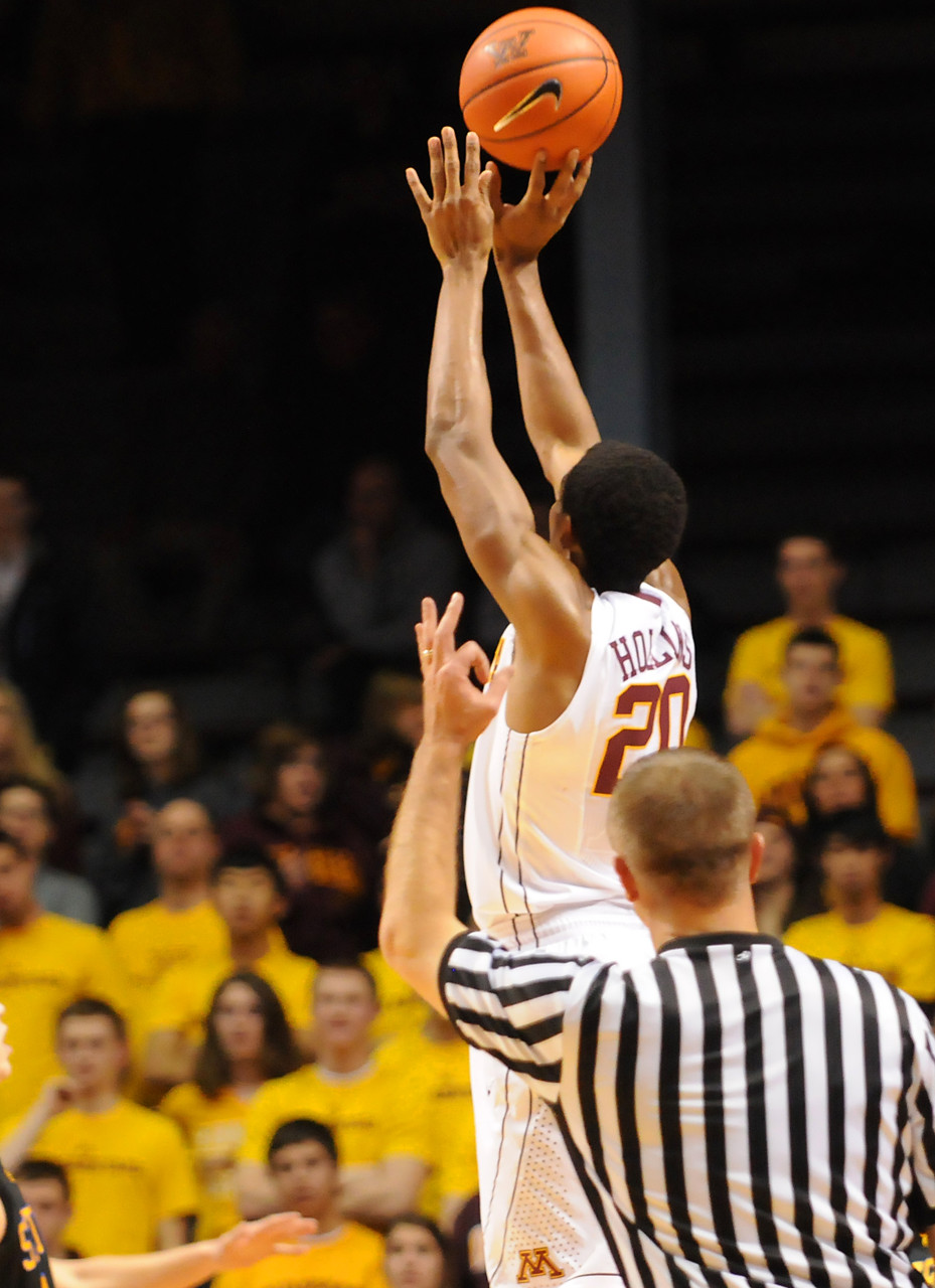 . Minnesota guard Austin Hollins (20) nails a three-pointer against South Dakota State in the first half. (Pioneer Press: John Autey)