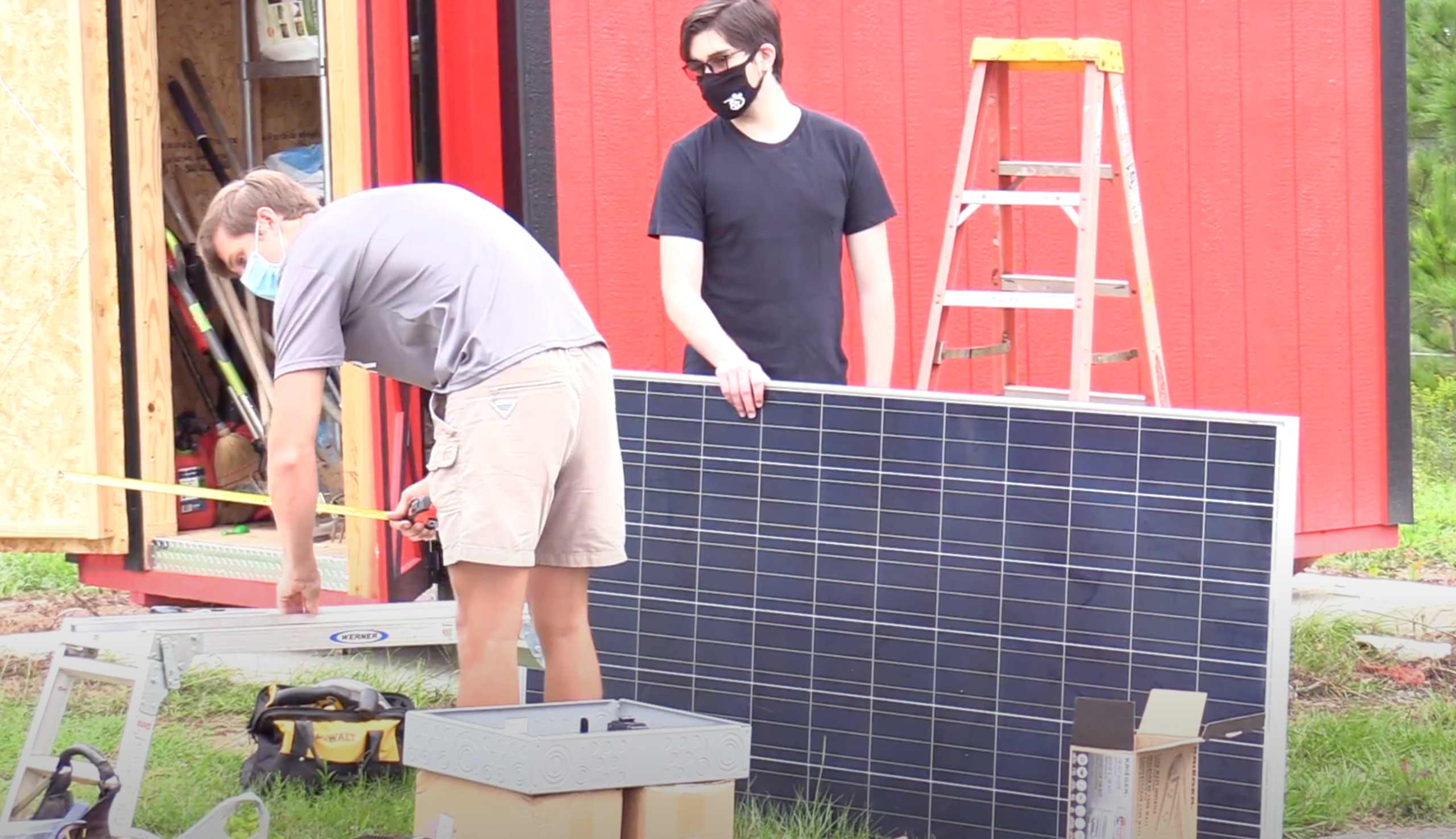 Physics students working on a solar panel.