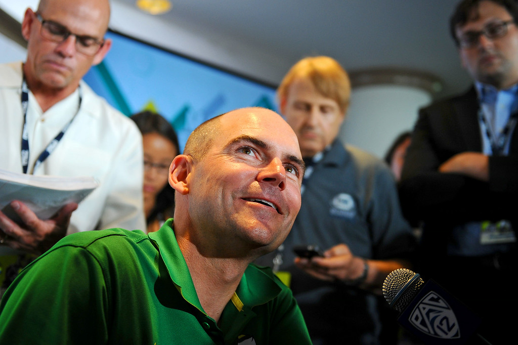 . Oregon Head Coach Mark Helfrich answers questions during PAC-12 Football Media Day at the Paramount Theater in Los Angeles, Ca July 23, 2014.(Andy Holzman/Los Angeles Daily News)