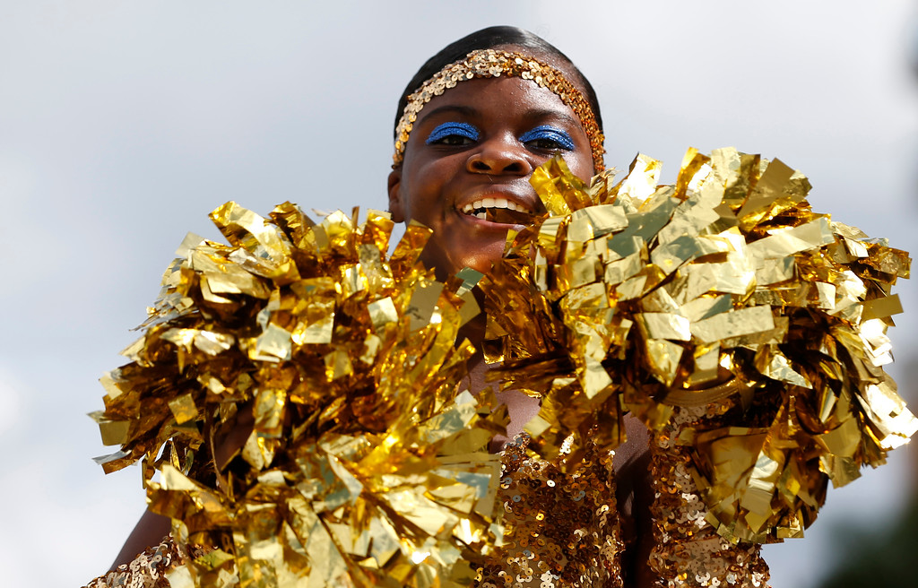 . North Miami Middle School cheerleader Chalyia Duverger performs during a parade honoring Dr. Martin Luther King Jr., Monday, Jan. 16, 2017, in the Liberty City neighborhood of Miami. (AP Photo/Wilfredo Lee)