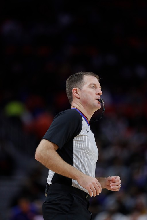 . Referee Brent Barnaky runs on the court during the first half of an NBA basketball game between the Detroit Pistons and the Cleveland Cavaliers, Monday, Nov. 20, 2017, in Detroit. (AP Photo/Carlos Osorio)