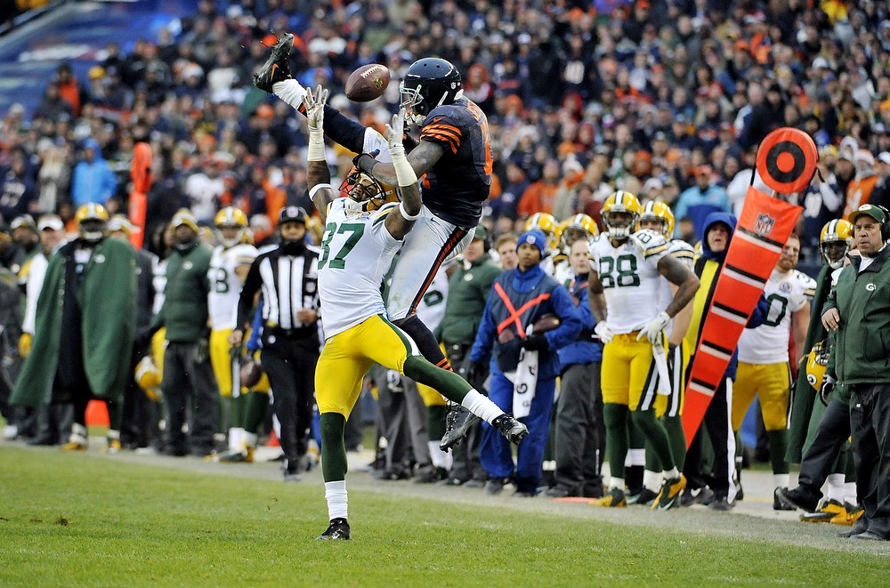 Description of . Sam Shields #37 of the Green Bay Packers breaks up a pass to Alshon Jeffery #17 of the Chicago Bearson December 16, 2012 at Soldier Field in Chicago, Illinois. The Green Bay Packers defeated the Chicago Bears 21-13.  (Photo by David Banks/Getty Images)