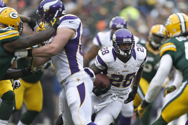 . Adrian Peterson #28 of the Minnesota Vikings runs the ball against the Green Bay Packers at Lambeau Field on December 2, 2012 in Green Bay, Wisconsin.  The Packers defeated the Vikings 23-14.  (Photo by Wesley Hitt/Getty Images)