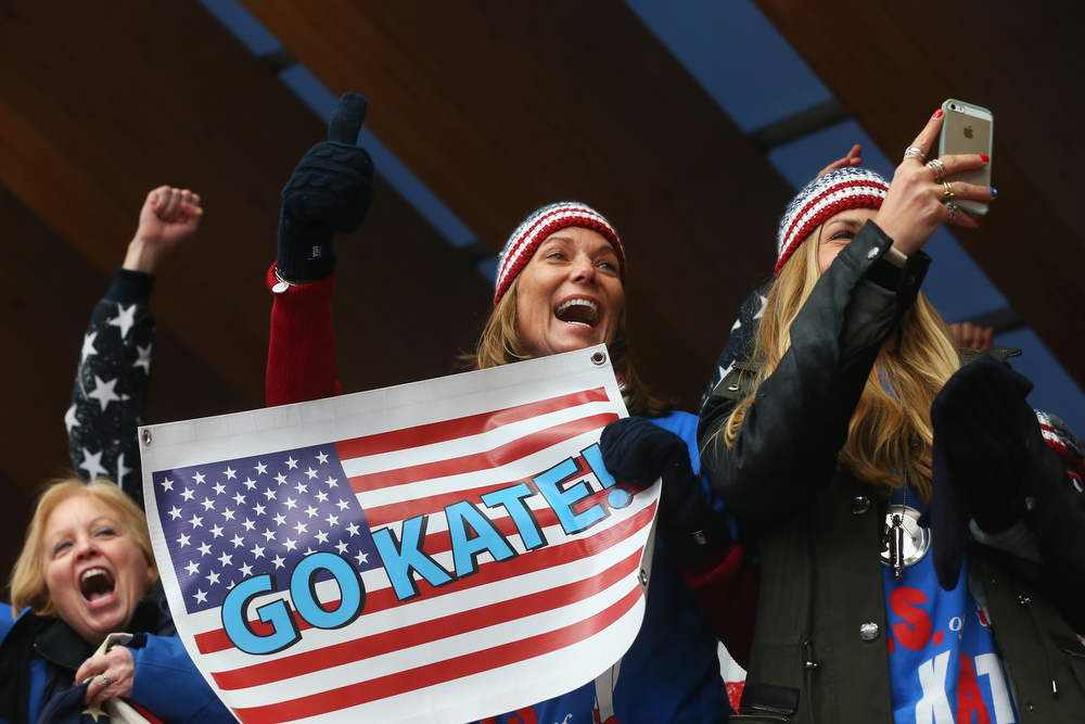 . Fans of the United States cheer at the finish area during the Women\'s Luge Singles on Day 4 of the Sochi 2014 Winter Olympics at Sliding Center Sanki on February 11, 2014 in Sochi, Russia.  (Photo by Alexander Hassenstein/Getty Images)