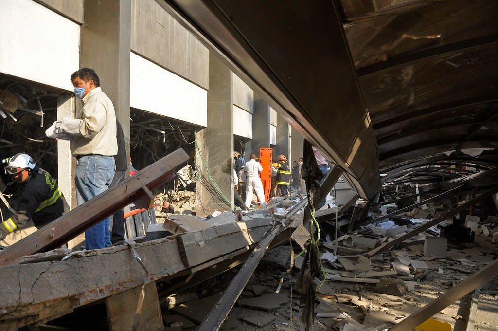 . Firefighters belonging to the Tacubaya sector and workers dig for survivors after an explosion at a building adjacent to the executive tower of Mexico\'s state-owned oil company PEMEX, in Mexico City, Thursday Jan. 31, 2013.    (AP Photo/Guillermo Gutierrez)