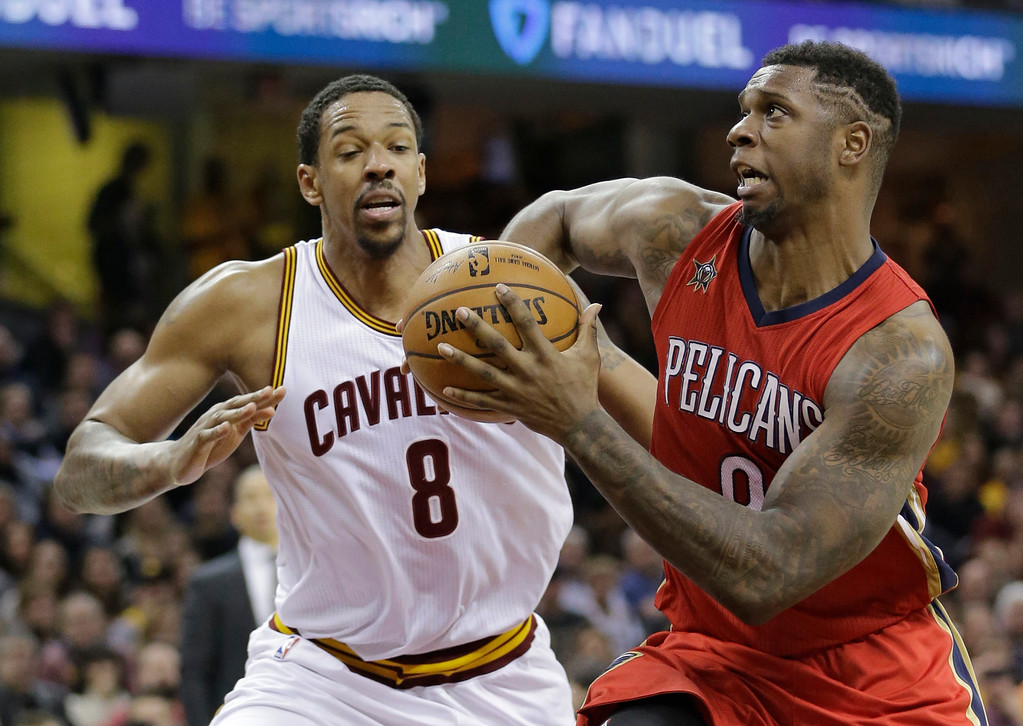 . New Orleans Pelicans\' Terrence Jones, right, drives against Cleveland Cavaliers\' Channing Frye in the second half of an NBA basketball game, Monday, Jan. 2, 2017, in Cleveland. The Cavaliers won 90-82. (AP Photo/Tony Dejak)