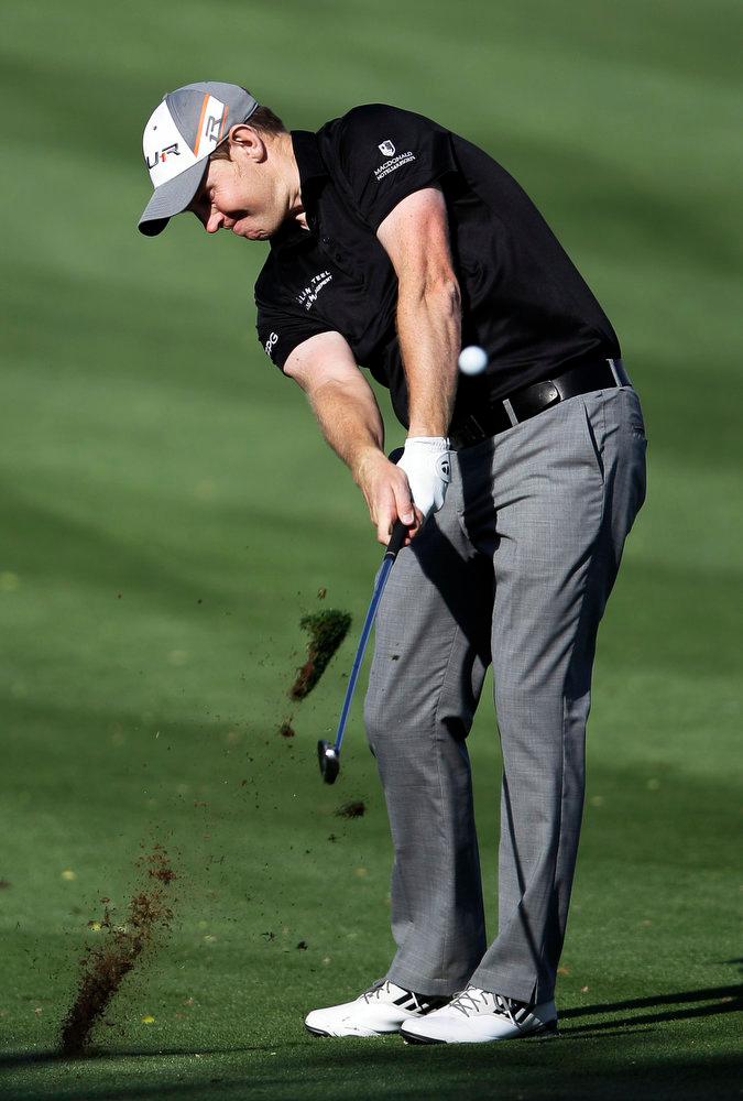 Description of . Stephen Gallacher of Scotland plays a ball on the 14th hole during the final round of the Dubai Desert Classic Golf tournament in Dubai, United Arab Emirates, Sunday, Feb. 3, 2013. (AP Photo/Kamran Jebreili)