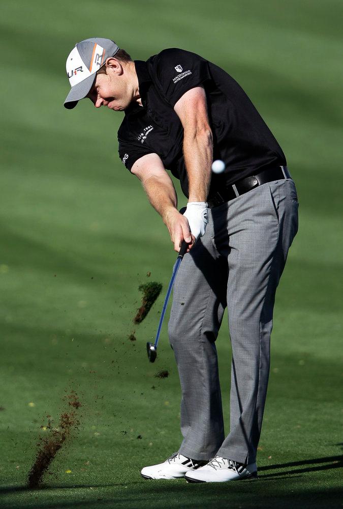 . Stephen Gallacher of Scotland plays a ball on the 14th hole during the final round of the Dubai Desert Classic Golf tournament in Dubai, United Arab Emirates, Sunday, Feb. 3, 2013. (AP Photo/Kamran Jebreili)