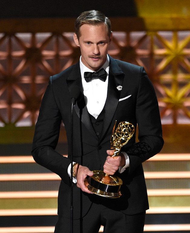 ". Alexander Skarsgard accepts the award for outstanding supporting actor in a limited series or a movie for ""Big Little Lies\"" at the 69th Primetime Emmy Awards on Sunday, Sept. 17, 2017, at the Microsoft Theater in Los Angeles. (Photo by Chris Pizzello/Invision/AP)"