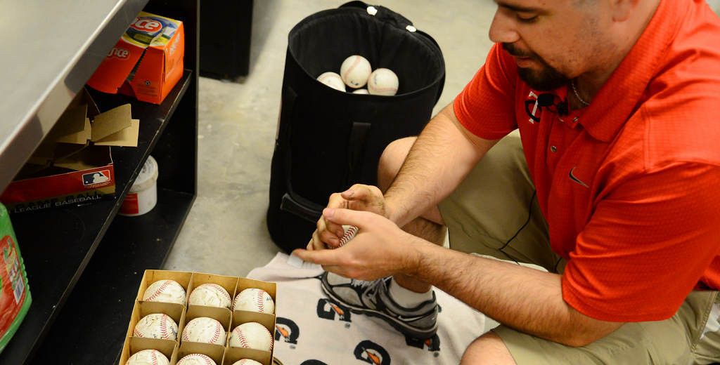 . Tim Burke muddies up new baseballs before the start of a game against the New York Yankees at Target Field. (Pioneer Press: John Autey)