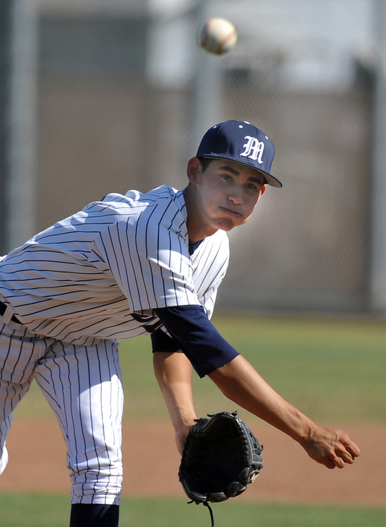 . Montebello\'s Daniel Lopez (#1) makes a pitch as they play Alhambra in their Almont League baseball game at Montebello High School in Montebello on Friday April 19, 2013. (SGVN/Staff Photo by Keith Durflinger)