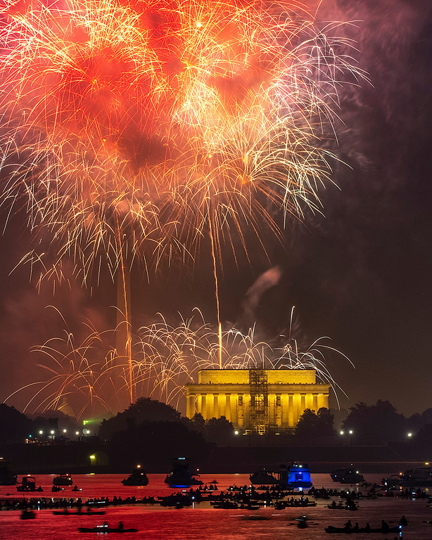 . Boaters on the Potomac River in Washington watch the fireworks display on the National Mall Wednesday, July 4, 2018, in celebration of Independence Day. (AP Photo/J. David Ake)