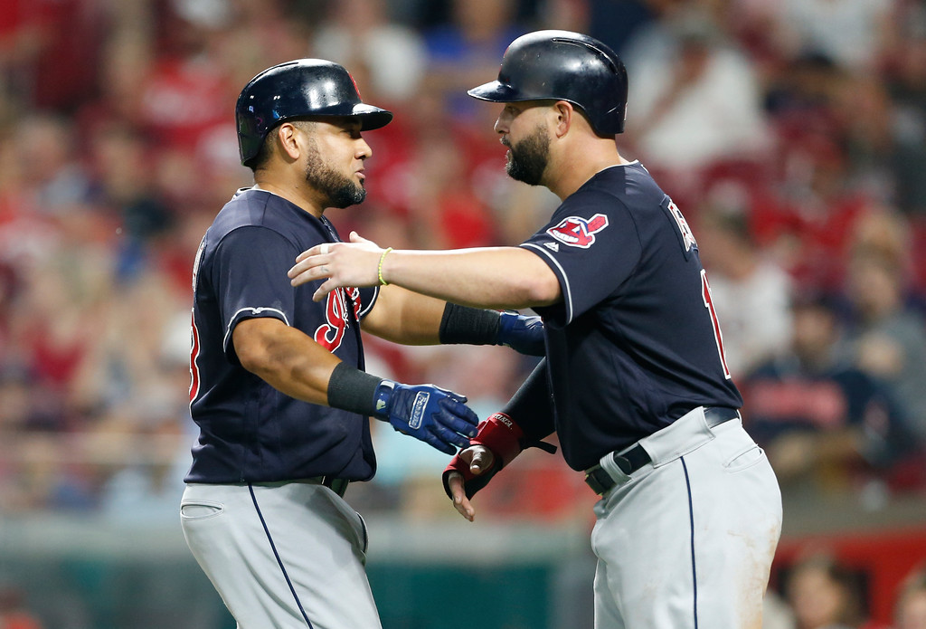 . Cleveland Indians\' Melky Cabrera, left, gets a hug from Yonder Alonso following Cabrera\'s a two-run home run off Cincinnati Reds relief pitcher Cody Reed during the sixth inning of a baseball game Wednesday, Aug. 15, 2018, in Cincinnati. (AP Photo/Gary Landers)