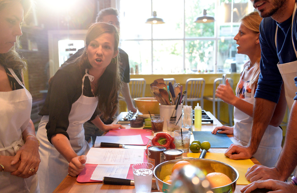 . DENVER, CO - JUNE 6: The Stir Cooking School at 3215 Zuni Street in Denver, hosted an Iron Chef styled cooking event  on Friday, June 6, 2014.  The evening pitted three tables competing against one another. Contestants left to right: Donna Kanger-Trujillo, Kristin Petty, and Sabrina Tockook strategize for their meal.  (Denver Post Photo by Cyrus McCrimmon)