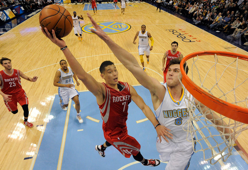 . DENVER, CO. - JANUARY 30: Houston Rockets point guard Jeremy Lin (7) drives to the basket on Denver Nuggets small forward Danilo Gallinari (8) during the fourth quarter January 30, 2013 at Pepsi Center.  The Denver Nuggets take on the Houston Rockets in NBA action. (Photo By John Leyba/The Denver Post)