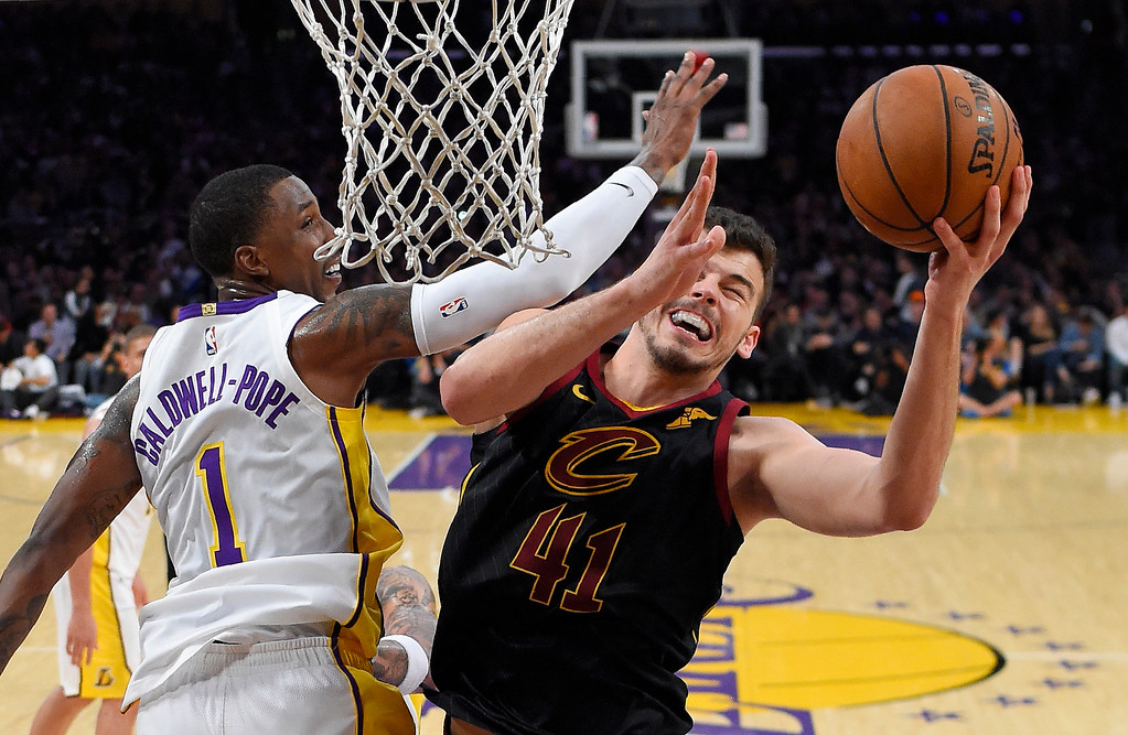 . Cleveland Cavaliers forward Ante Zizic, right, of Croatia, shoots as Los Angeles Lakers guard Kentavious Caldwell-Pope defends during the second half of an NBA basketball game, Sunday, March 11, 2018, in Los Angeles. The Lakers won 127-113. (AP Photo/Mark J. Terrill)