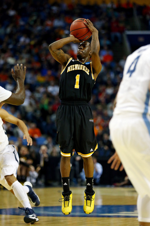 . BUFFALO, NY - MARCH 20: Jordan Aaron #1 of the Milwaukee Panthers takes a shot against the Villanova Wildcats during the second round of the 2014 NCAA Men\'s Basketball Tournament at the First Niagara Center on March 20, 2014 in Buffalo, New York.  (Photo by Elsa/Getty Images)