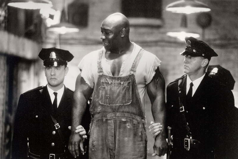 """. This undated image provided by Warner Bros. shows Tom Hanks, left, Michael Clarke Duncan, center, and David Morse in \""""The Green Mile.\"""" Duncan has died at the age of 54 on Monday, Sept. 3, 2012 in a Los Angeles hospital after nearly two months of treatment following a July 13, 2012 heart attack, his fiancee, the Rev. Omarosa Manigault, said. Michael Clarke Duncan ranked as Google\'s fourth most searched trending person of 2012. (AP Photo/Warner Bros., Ralph Nelson)"""