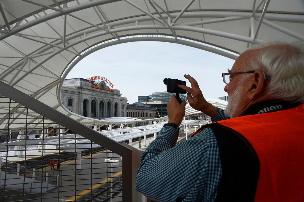 . DENVER, CO. - APRIL 25: Denver photographer, Steve Larson, photographs the Train Hall area of the new Union Station Transit Center on a media tour April 25, 2014. (Photo By Andy Cross / The Denver Post)