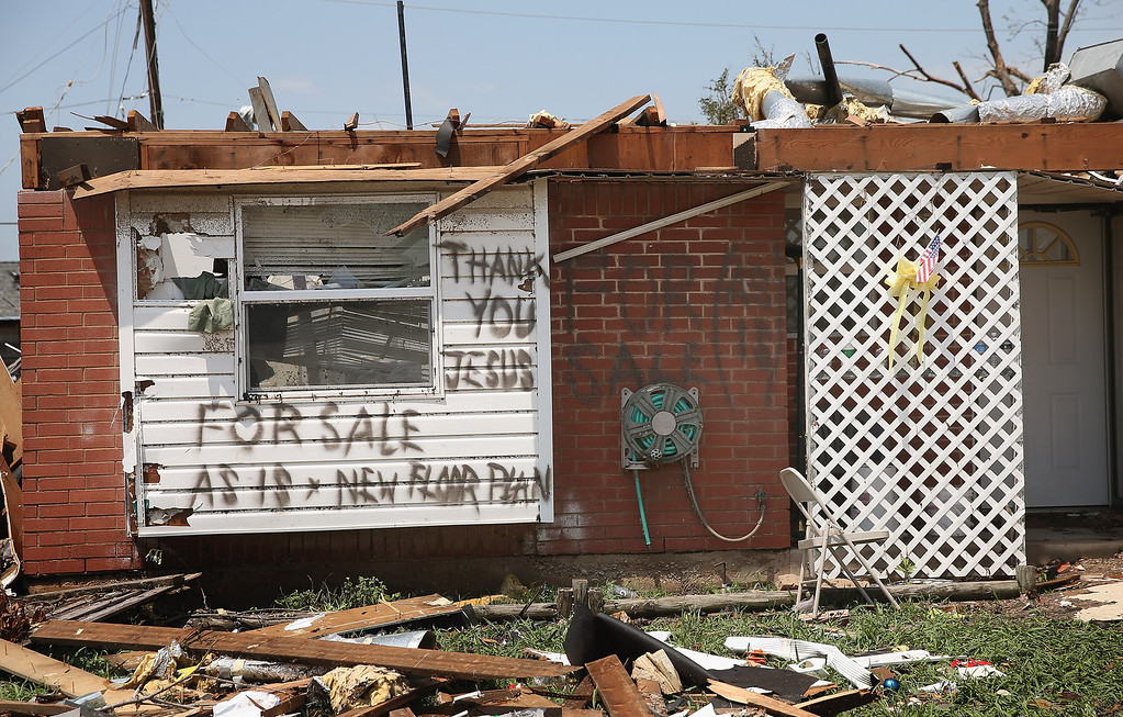 . MOORE, OK - MAY 23: A homeowner displays a humorous message after his home was destroyed by a tornado, on May 23, 2013 in Moore, Oklahoma. A two-mile wide EF5 tornado touched down in Moore May 20 killing at least 24 people and leaving behind extensive damage to homes and businesses. U.S. President Barack Obama promised federal aid to supplement state and local recovery efforts.  (Photo by Scott Olson/Getty Images)