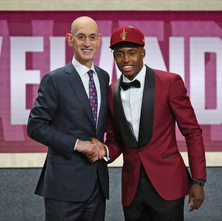. Alabama\'s Collin Sexton, right, poses with NBA Commissioner Adam Silver after he was picked eighth overall by the Cleveland Cavaliers during the first round of the NBA basketball draft in New York, Thursday, June 21, 2018. (AP Photo/Kevin Hagen)