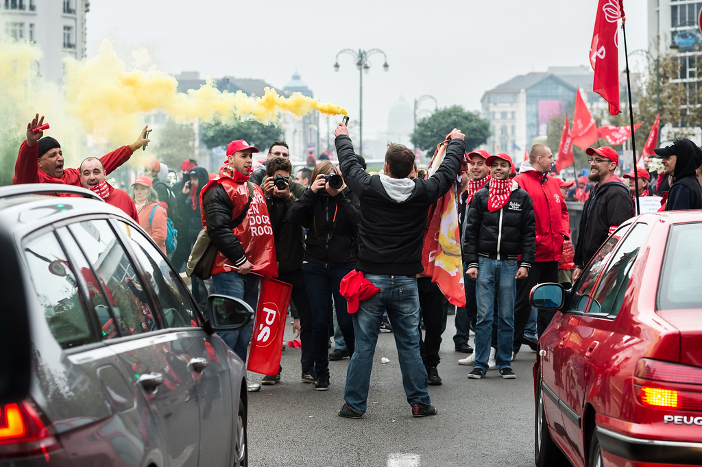. Workers stop cars on a main boulevard during a national trade union demonstration in Brussels, Thursday Nov. 6, 2014. (AP Photo/Geert Vanden Wijngaert)