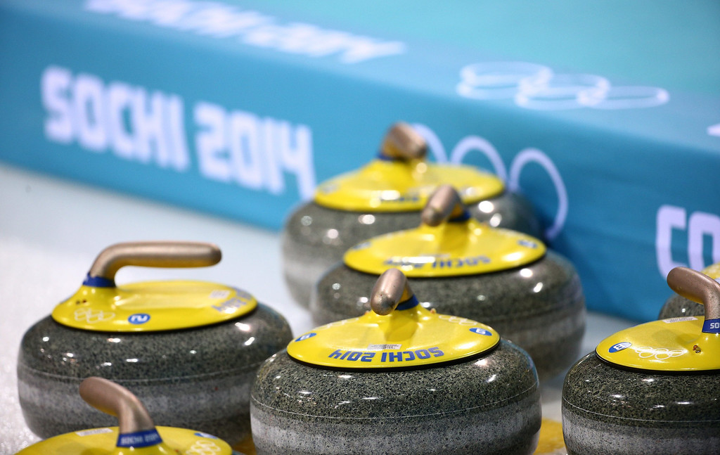 . Curling stones are seen during the round robin match between Germany and Canada during the curling tournament.  EPA/Christian Charisius