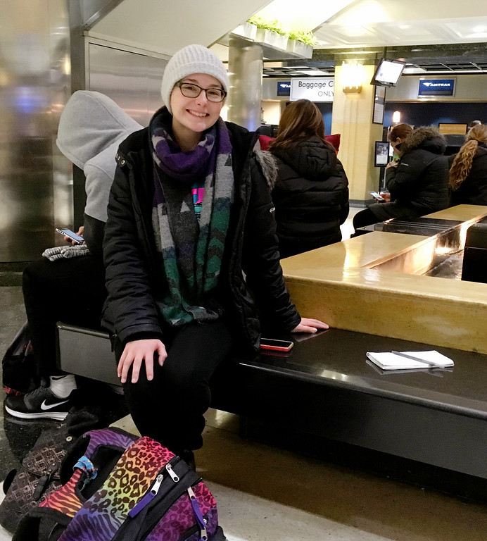 . Elizabeth Thompson, 23, rests in the Amtrak station in Chicago on Wednesday, Nov. 23, 2016, as she tries to figure out how she\'ll get to her grandmother\'s house in Edinburgh, Ind., for Thanksgiving. Thompson missed her first train to Galesburg, Ill., where she planned to catch a ride with a family member the rest of the way. (AP Photo/Tammy Webber)