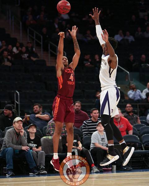 Virginia Tech's guard Nickeil Alexander-Walker (4) shoots over a Washington defender in Madison Square Garden, Nov. 17, 2017. Virginia Tech won the game 103-79.