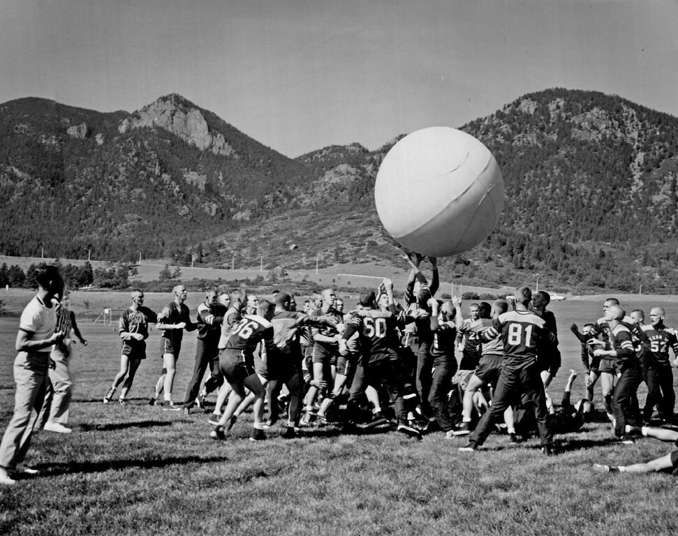 """. This is Known as Push Ball Action such as this will be featured Saturday at the Air Force Academy when the \""""doolies\"""" (freshmen) conduct their annual Field Day, beginning at 8 a.m. on the Academy athletic fields located north of the cadet gymnasium. Over 1,400 \""""doolies\"""" will take part in physical contest, and this ends four weeks of physical and military training. 1970. The Denver Post Library Archive"""