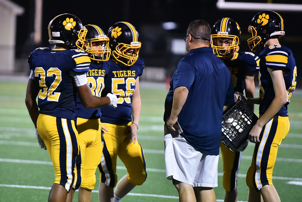. Littleton huddles for a timeout during the second half of Friday night\'s game at home against Hudson.  Sun/Jeff Porter