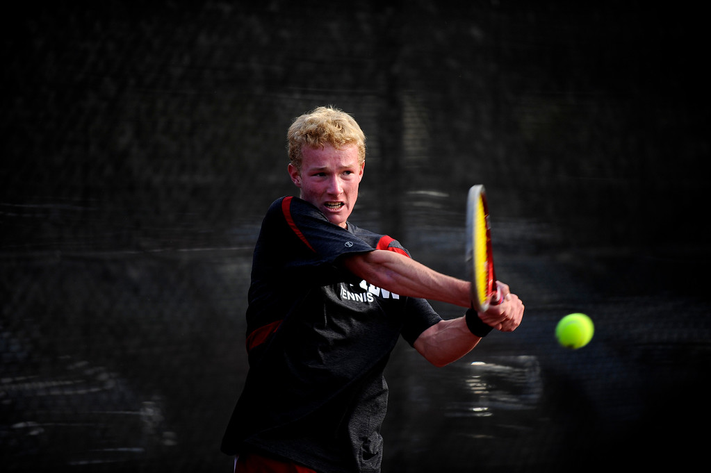 . DENVER, CO. - OCT 12:   Fairview player Thomas Mason hits against Cherry Creek\'s Ethan Hillis during the #3 singles match.  (Photo By Erin Hull/The Denver Post)