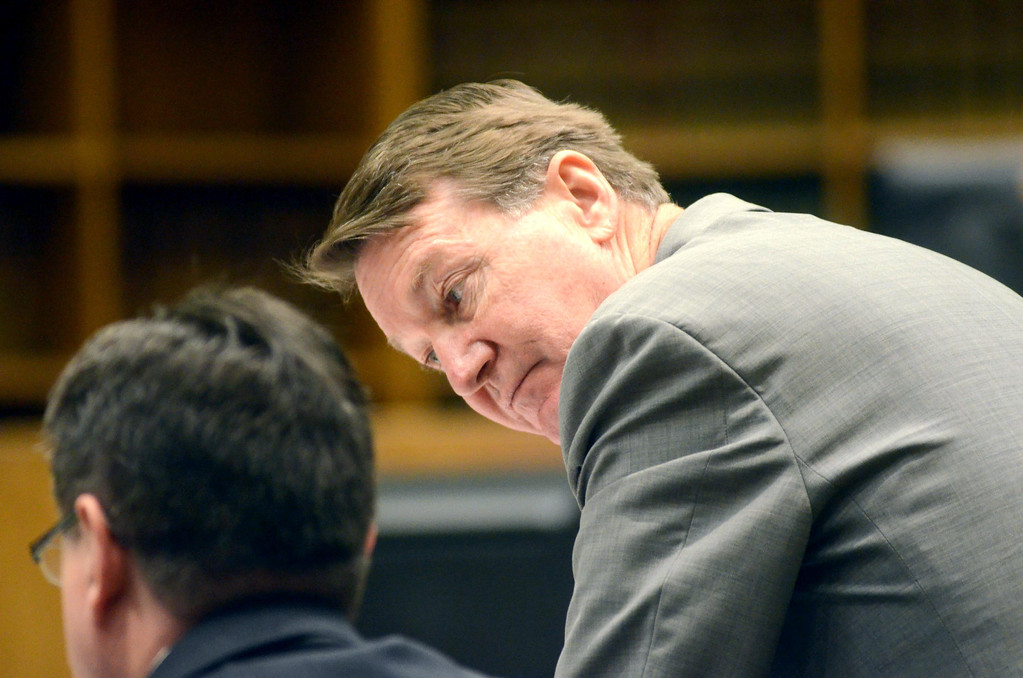 . Berkshire District Attorney David Capeless confers with First Assistant Distric Attorney Paul J. Caccaviello during the Adam Hall trial in Springfield on Wednesday, January, 22, 2014. Gillian Jones/Berkshire Eagle Staff