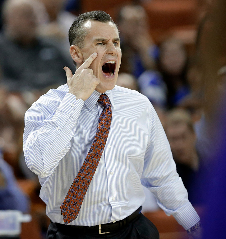 . Florida coach Billy Donovan talks to his players during the first half of a second-round game against Northwestern State in the NCAA men\'s college basketball tournament Friday, March 22, 2013, in Austin, Texas.  (AP Photo/Eric Gay)