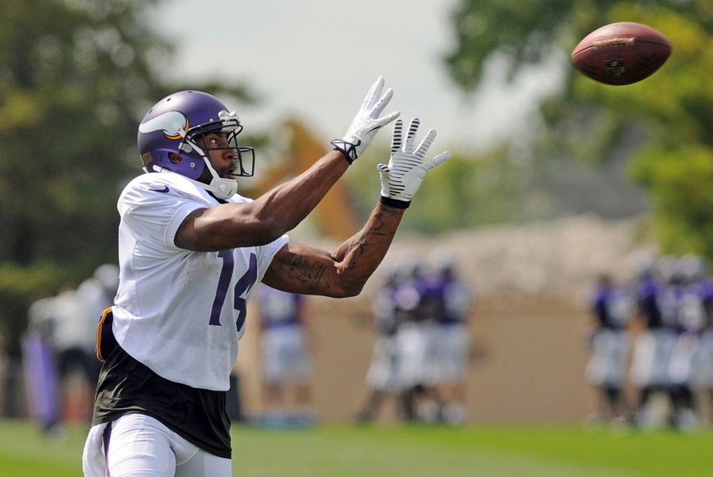 . Vikings wide receiver and former quarterback Joe Webb zeros in on a pass on the last day of training camp.  (Pioneer Press: Chris Polydoroff)