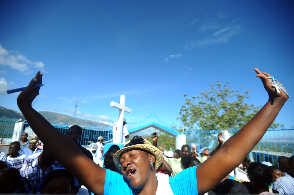 . A woman prays during the pilgrimage at Morne Calvaire on Good Friday in Port-au-Prince on April 18, 2014.  (HECTOR RETAMAL/AFP/Getty Images)